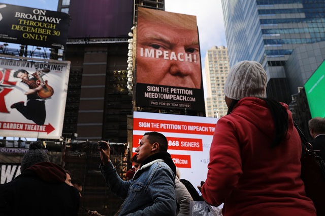 billboard in Times Square, funded by Philanthropist Tom Steyer, calls for the impeachment of President Trump on November 20, 2017, NYC. - Spencer Platt:Getty