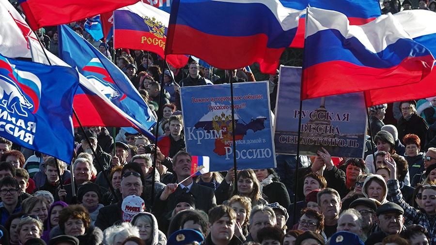 Citizens of Sevastopol during a rally held in Nakhimov Square as part of the celebrations of the first anniversary of Crimea's reunification with Russia. © Vasiliy Batanov : Sputnik