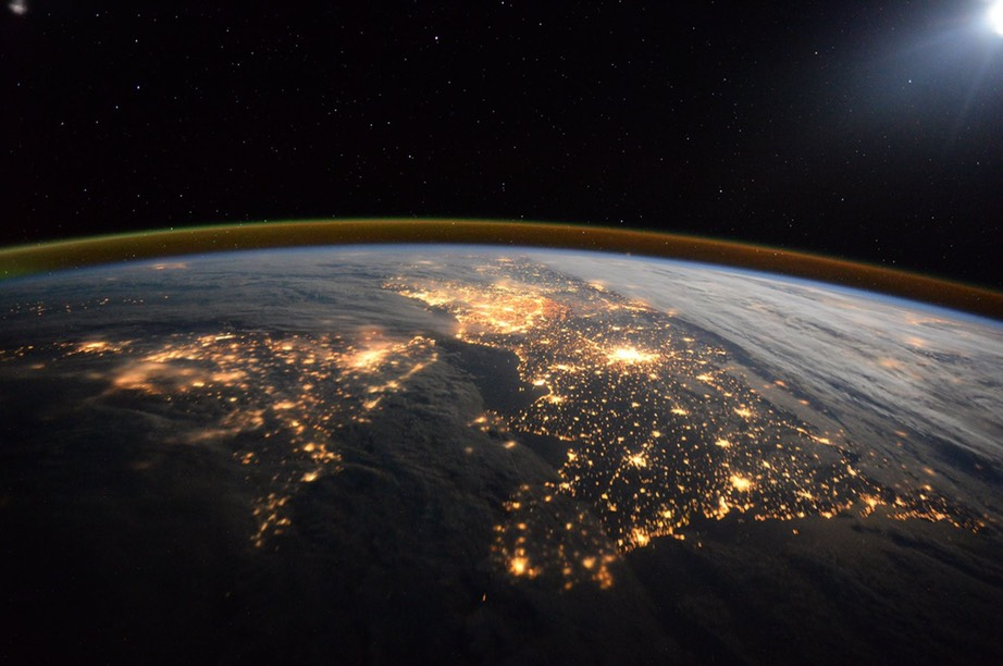 east along the Channel with UK on the left and France on the right. Streetlights from the densely-populated London, Paris and Brussels glow brightly in the centre of the picture. -Tom Peake