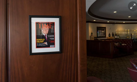 Framed portrait of President Donald Trump on the cover of a Time Magazine hanging from a column in the Champions Sports Bar & Grill at the Trump National Doral Miami. -Washington Post:Getty Images