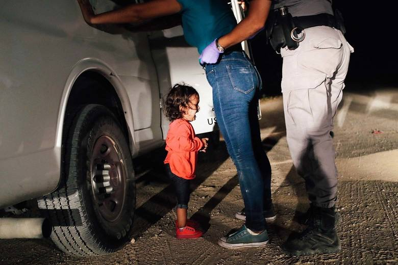 Honduran girl cries as her mother is searched and detained near the U.S.-Mexico border on Tuesday in McAllen, Texas. John Moore:Getty