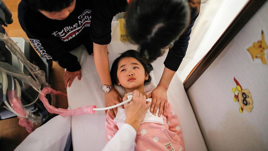 In Iwaki, a town south of the Fukushima nuclear plant, a doctor conducts a thyroid examination on 4-year-old Maria Sakamoto -Toru Hanai/Reuters