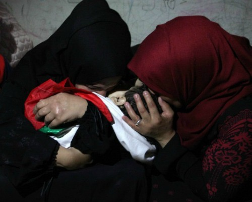 mother and aunt of 8-month-old Laila mourn during her funeral in Gaza City, which Haley somehow missed. Photo by Mahmoud Ajour:APA Images