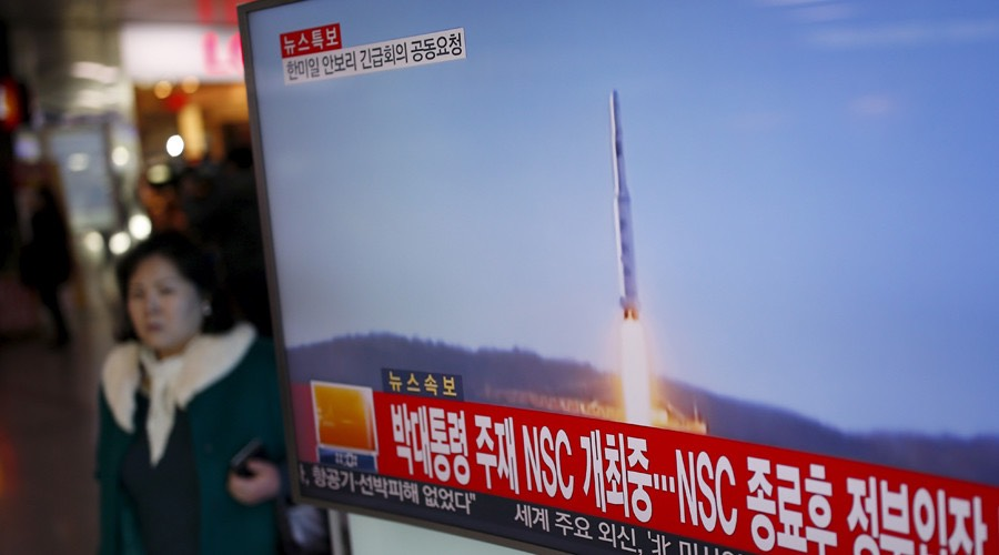 passenger walks past a TV screen broadcasting a news report on North Korea's long range rocket launch -Kim Hong-Ji : Reuters