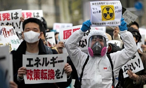 Protesters at an anti-nuclear rally in Tokyo, March, 2011. The signs read- 'Change energy policy' and 'Do not sprinkle radioactive material'. -Jean Baptiste, Paris/Creative Commons
