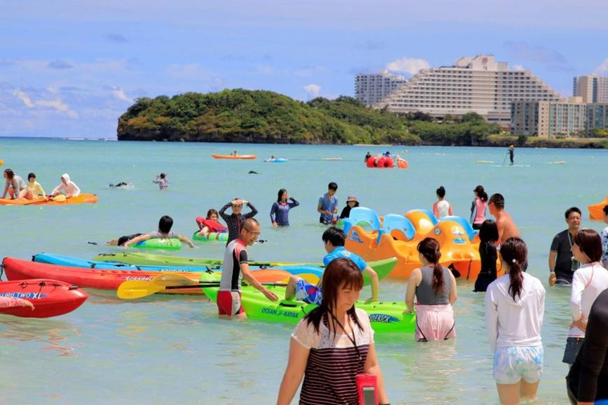 Tourists enjoy Guam's Tumon Beach on Friday. | AFP-JIJI