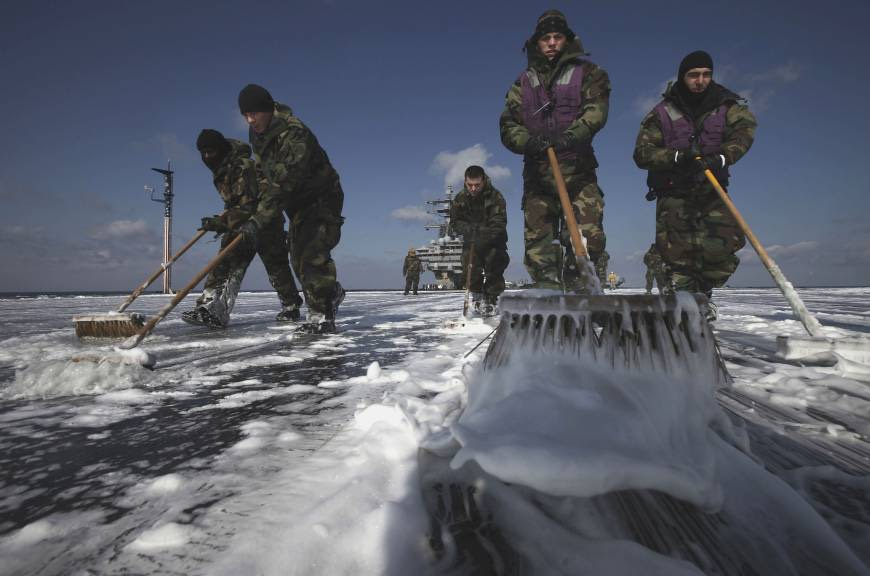 Unprotected_US_Navy_sailors_sweep_radioactive_fallout_from_USS_Ronald_Reagan_March_23_2011_off_Tohoku_coast_during_10_day_rescue_and_aid_missions_in_wake_of_3/11-AP